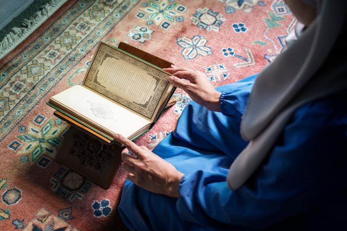 Muslim woman reading the quran